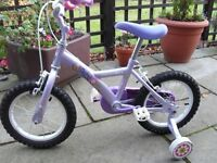Girls Appolo bike with stabilisers.
