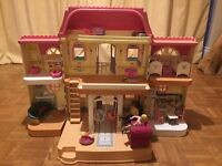 My family loving dolls house by Fisher Price