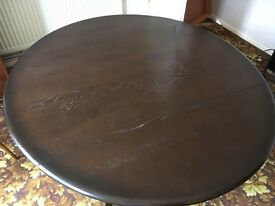 Ercol dark wood gate-legged drop leaf dining table and 4 matching chairs