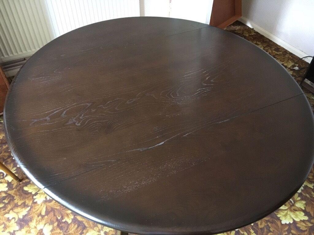 Ercol dark wood gate legged drop leaf dining table and 4 matching chairs. Ercol dark wood gate legged drop leaf dining table and 4 matching