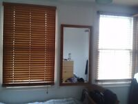 Wooden Venetian slatted blinds