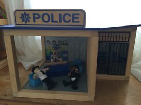 Wooden Police Station with people