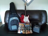 SQUIER MINI ELECTRIC GUITAR , AMP , BAG AND BOOKS