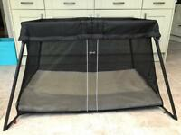 Babybjörn travel cot with fitted sheet.