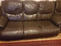 A leather 3 seats sofa and ×2 recliner chairs in very good condition