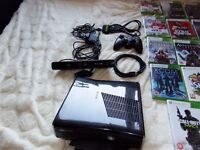 Xbox 360 with Kinect and 14 game bundle ( Very good condition hardly used)