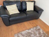 Black faux leather 2 seater sofa