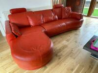 Red leather corner sofa and hand chair