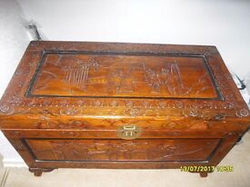 TWO CARVED WOODEN CHESTS