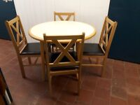 "ROUND TABLE & 4 ""X"" BACKED CHAIRS"