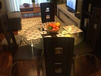 Collect today! Glass dining table and 4 chairs
