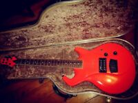 Dayglo Orange Switch Vibracell guitar in case