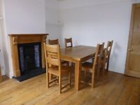 Solid reclaimed oak dining table and 6 chairs