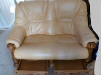 2 seat leather sofa with solid wooden base and 2 storage draws