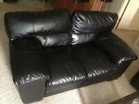 GENTLY USED Black leather couches