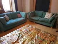 Two three seater teal / sapphire sofas