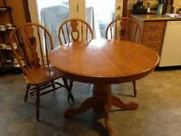 Round oak pedestal table with leaf and 3 chairs