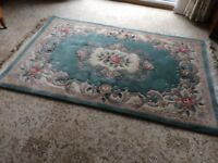 Green Chinese rug with fringe. Thick deep pile. Lovely to walk on.