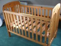 A really sturdy Maclaren cot in pine. Delivery