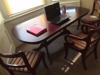Magnificent mahogany table + 6 chairs for free!