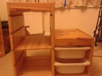 Ikea Trofast storage unit with a shelf and two pull-out boxes