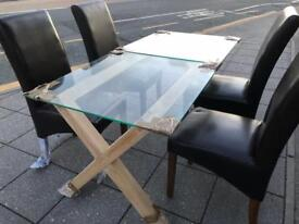 Gorgeous brand new glass dining table with chairs
