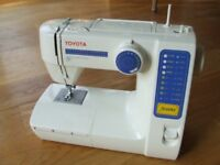 Toyota sewing machine with electronic control. Toolkit bobbins etc. Suit hobbyist/beginner.