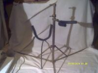 "SAXOPHONE STAND for a BARITONE SAX . VERY LIGHTWEIGHT "" BUT "" It DOES DO THE JOB +"
