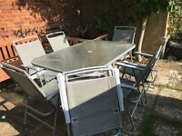 Patio table & 8 folding chairs