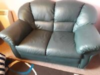 Green hardback sofa very good condition pet and smoke free selling due to colour