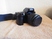 CANON EOS 1000F SLR FILM CAMERA WITH CANON ZOOM LENS 35-80mm