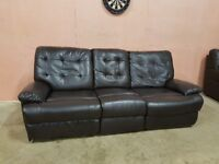 Faux leather reclining 3 seater sofa in good condition. Can deliver