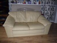 Cream leather two seater settee, modern on wooden feet Good Condition. FREE TO THE COLLECTOR