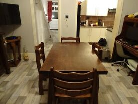 Lovely solid oak table and 4 chunky chairs