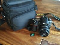 D7000 DSLR, almost new with 35mm lens, bag, and memory card