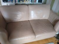 Leather 2 seat sofa, beige coloured, modern with curved ends, good condition £90