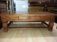 Lovely brown solid wood coffee table with chest of drawers. excellent condition.