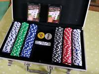 Poker chips and playing cards in case