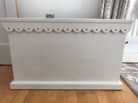 A beautiful white ottoman from chic shack