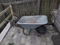 Used metal wheelbarrow
