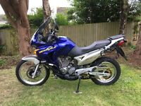 Honda transalp 650, low miles and unmarked condition, loaded with touring extras. Best available.