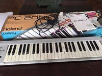 Roland Synthesizer PC 200 Mk 2 with power supply.