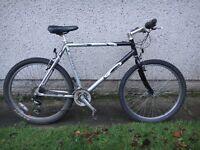Carrera Vulcan mountain bike, 26 inch wheels, 21 gears, 22 inch aluminium frame, black / silver