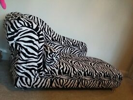 Small Zebra print Chaise lounge and roll cushion