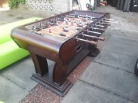 Wooden Table Football. In great working order and a lot of fun. Dark wood with brass trim