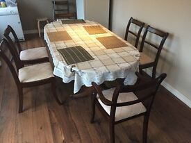 Large dinning table with 6 chairs