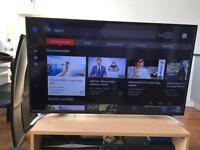2 Tvs with table and speakers