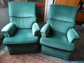 Two Green Velour reclining armchairs