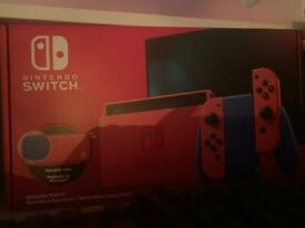Nintendo switch mario red and blue edition bundle