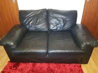 2 black lether sofas